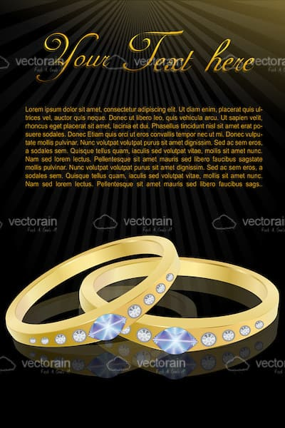 Pair of Golden Rings with Jewels and Sample Text
